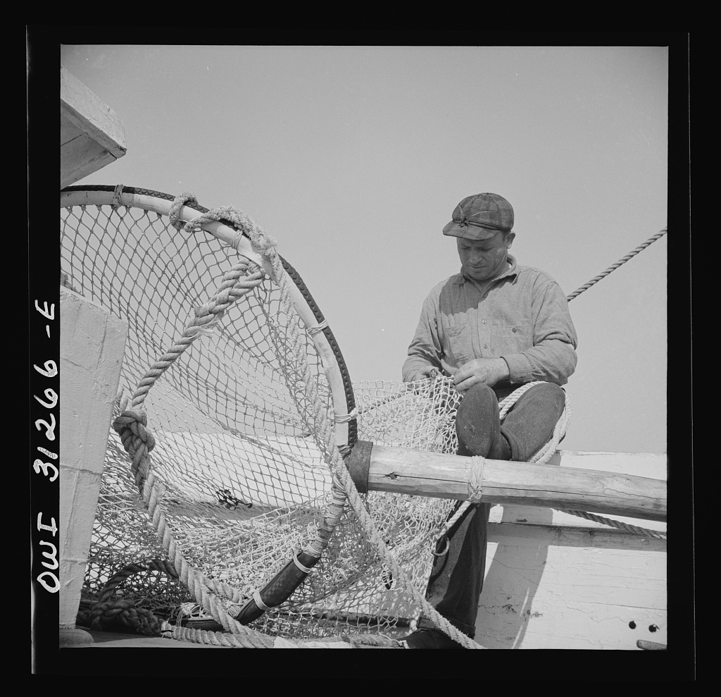 Frank Mineo, owner and skipper of the New England fishing boat Alden. Gloucester, Massachusetts. July 1943