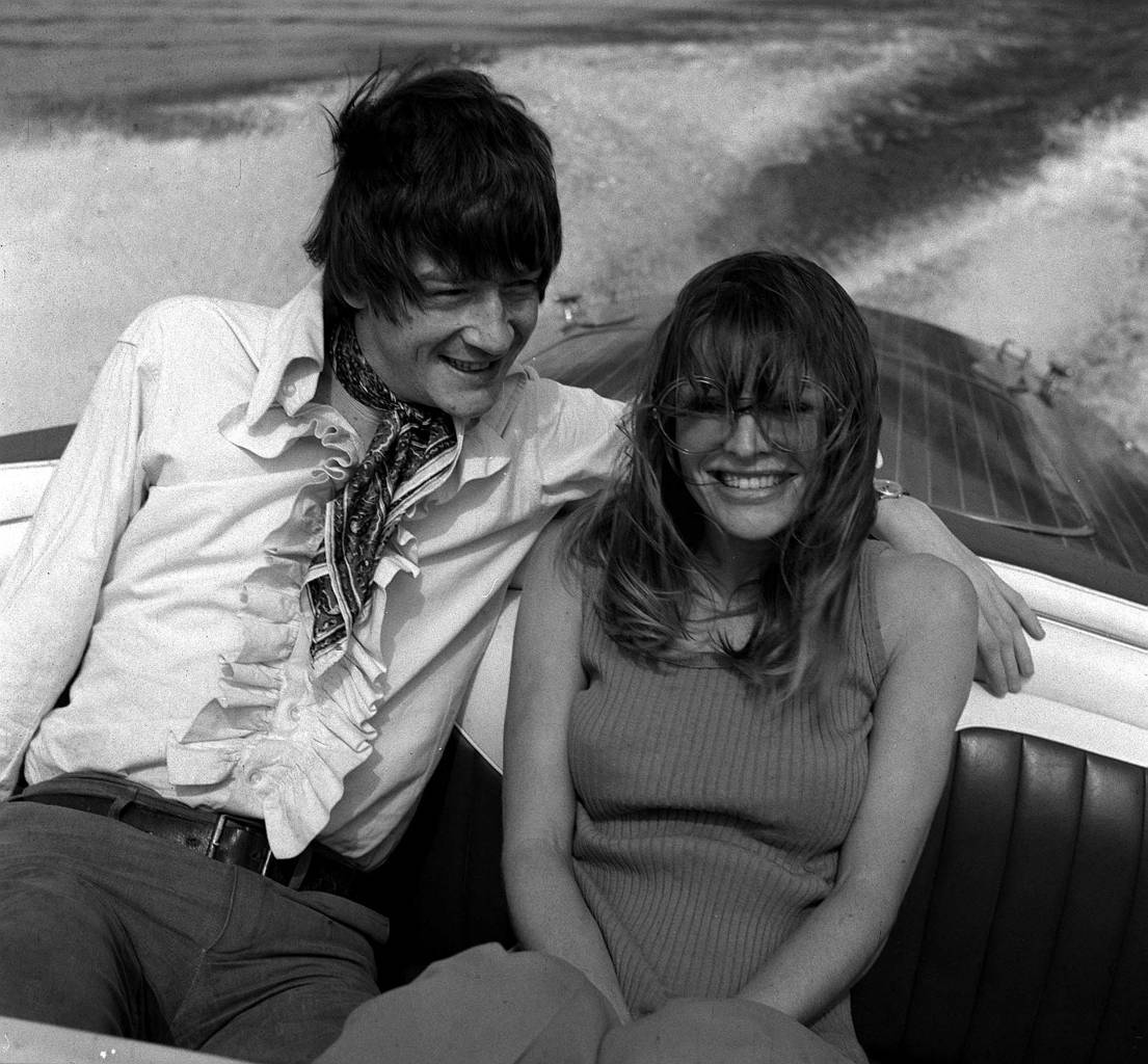 """John Hurt and Julie Christie speed over the Lake of Geneva in Switzerland where they are making the film """"In Search of Gregory"""""""