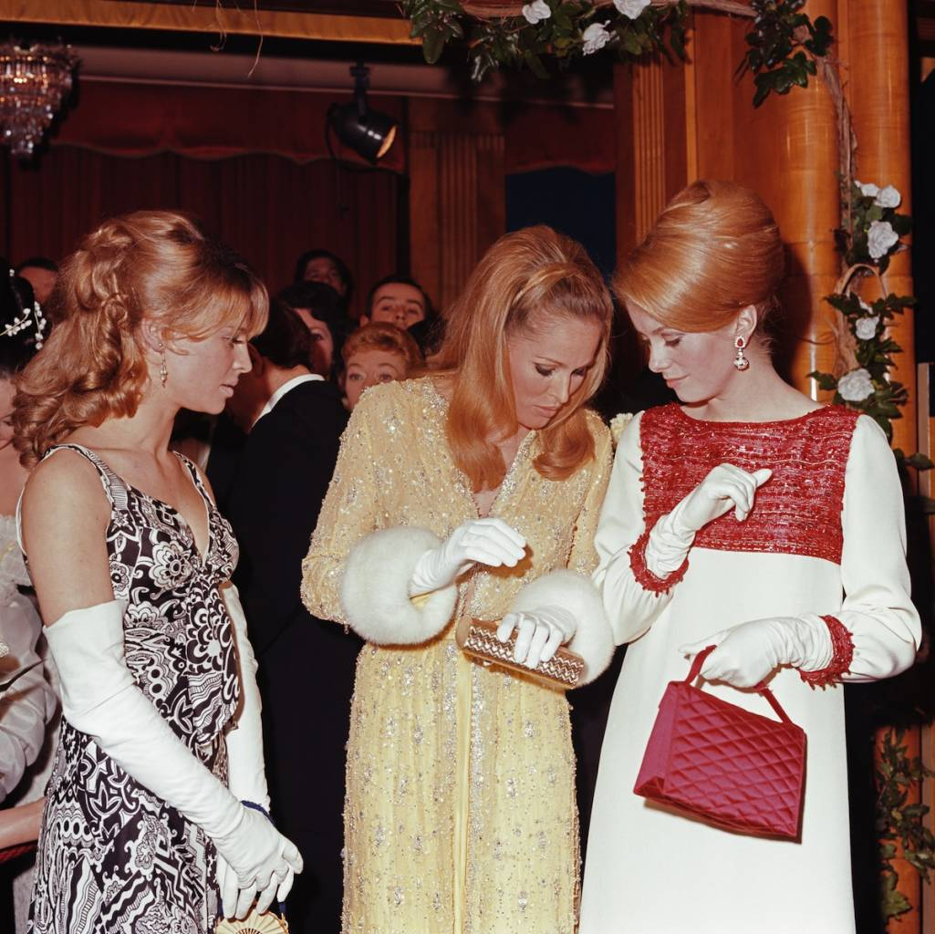 From left to right, actresses Julie Christie, Ursula Andress and Catherine Deneuve attend a Royal Film Performance of 'Born Free' at the Odeon, Leicester Square, 14th March 1966.   (Photo by George Freston/Getty Images)