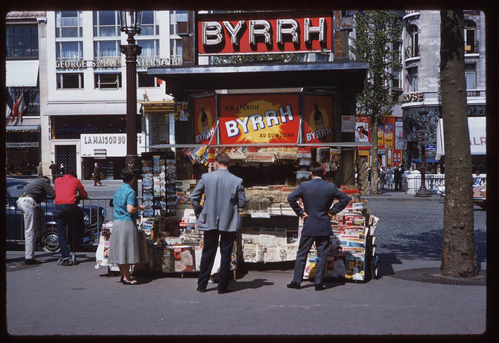 May 8, 1960. News stand Paris Rue Marignan and Champs Elysee.