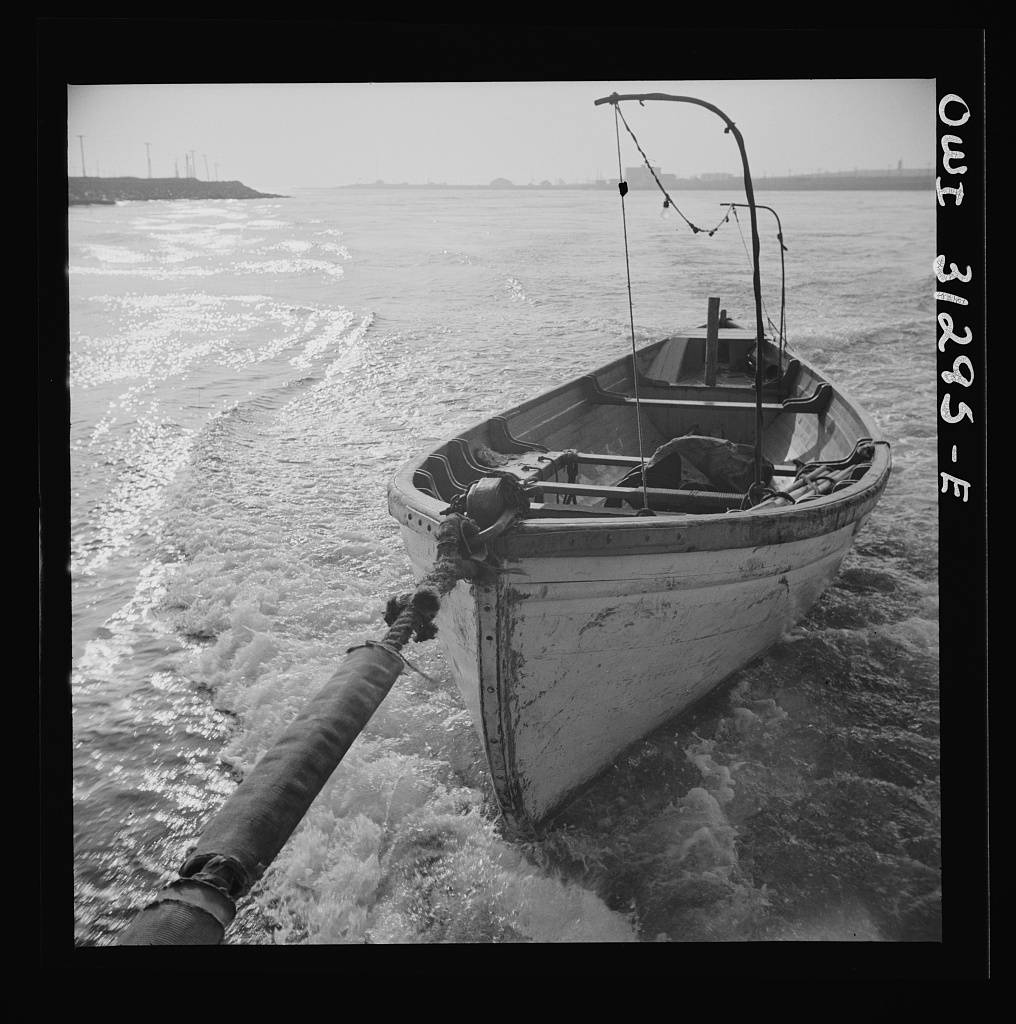 Seining boat being towed by the Alden