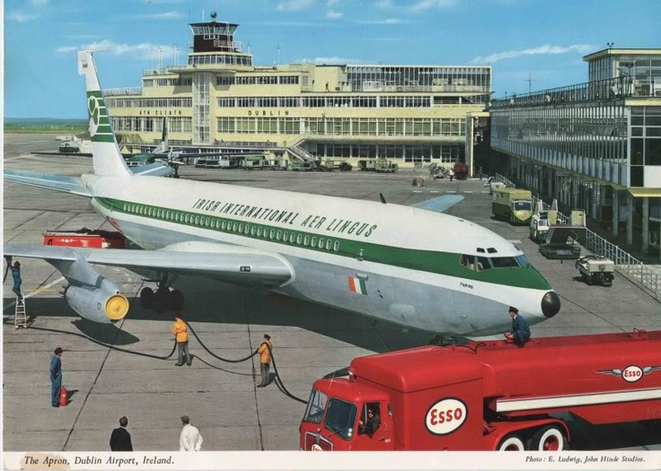 The Apron at Dublin Airport by Elmar Ludwig. A John Hinde postcard of the late 1960s:early 1970s with showing the Old Terminal building and Pier A - now the 100 gates on the right.