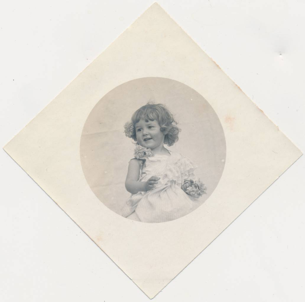 Perhaps unsurprisingly, this smiling cherub hails from France. The classic period for the diamond photos is 1890 (give or take) to 1910. If this example is from that period, the candid pose is unusual. [The Carefree Cherub]