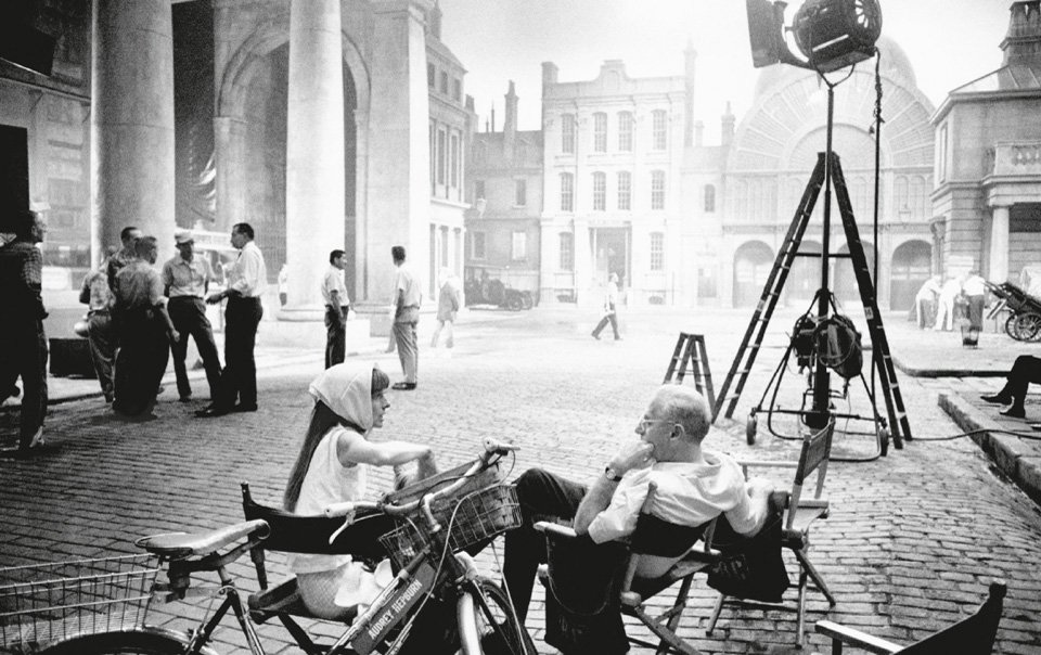 Audrey Hepburn with director George Cukor, filming My Fair Lady.