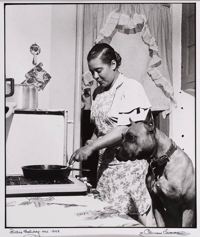 "Originally included in a 1949 cover story for Ebony magazine, this photograph shows Holiday at home in her Harlem apartment cooking a steak with her beloved boxer, Mister. The article, titled ""I'm Cured for Good,"" came after numerous incidents with the law due to Holiday's ongoing struggle with narcotics. This was the first time Leonard had ever met the singer. ""On arriving, I was greeted by a woman in an apron and housedress,"" recalled Leonard, ""whom I initially mistook for the maid, until I realized she was the great Billie Holiday."" Via"