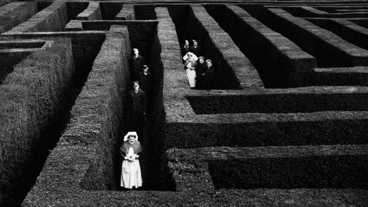 Soldiers and nurses lost in the maze at Hatfield House, Hertfordshire, England, 1940