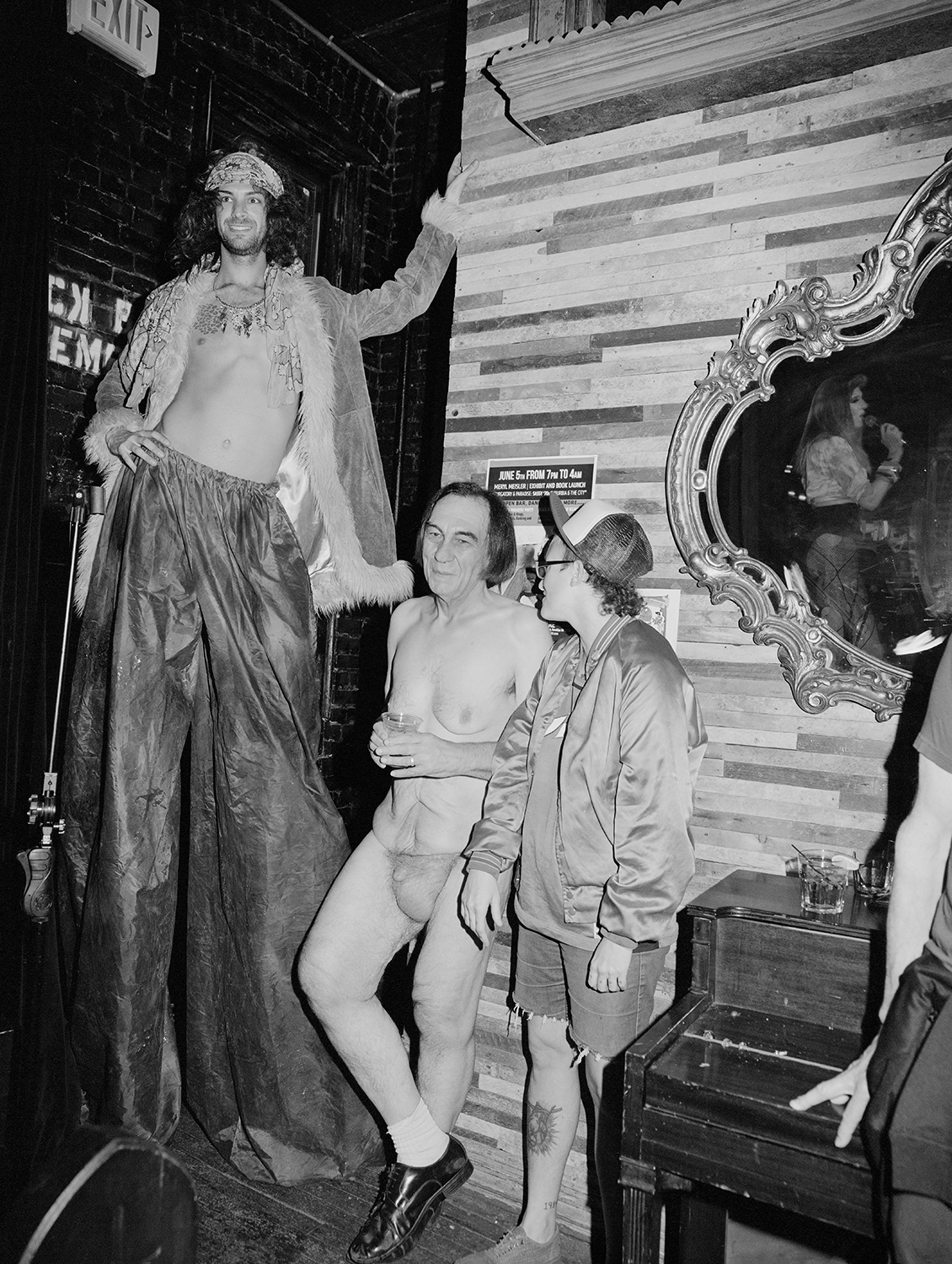 On Stilts Next To Naked Man, Bizarre Bushwick