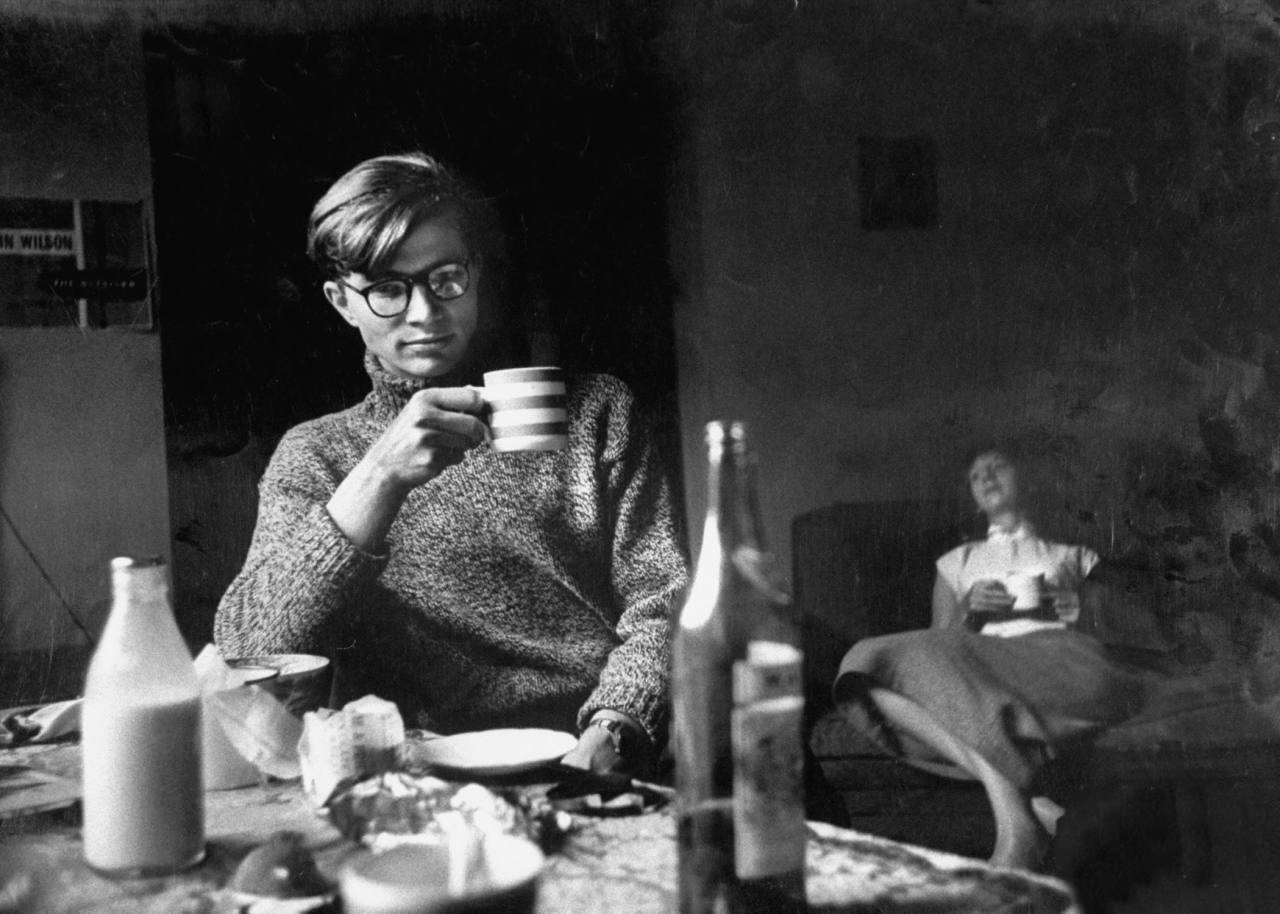 Colin Wilson drinking tea with his girlfriend Joy.