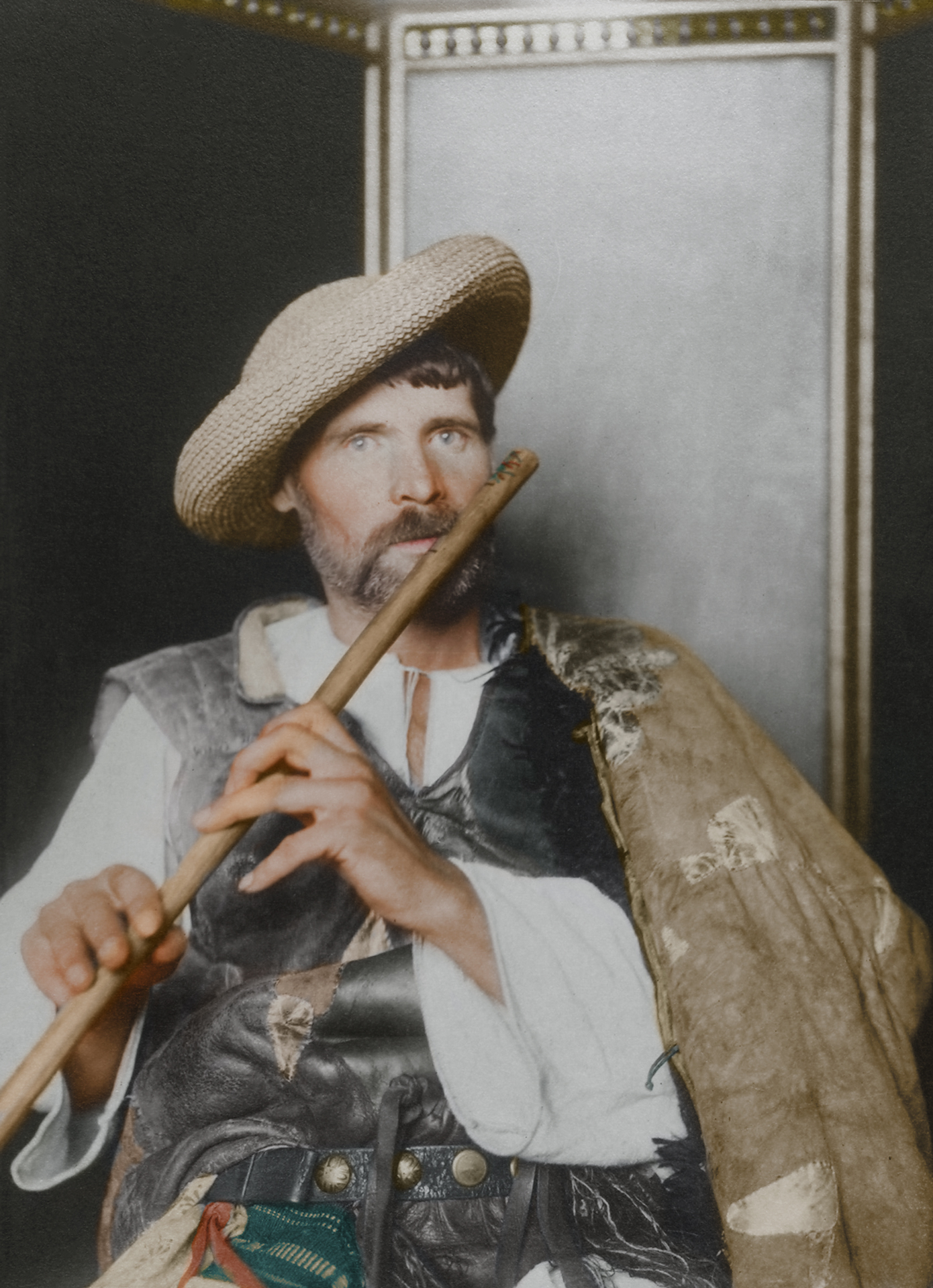 "c. 1910 ""Romanian piper."" This particular cojoc, an embroidered sleeved sheepskin coat is much plainer than the shepherd's version, making it a more practical, work oriented coat, suggesting that the subject is of the working class given the lack of decoration and the straw hat. The waistcoat, known as a pieptar is worn by both men and women, and smaller waistcoats were made from lambskin."