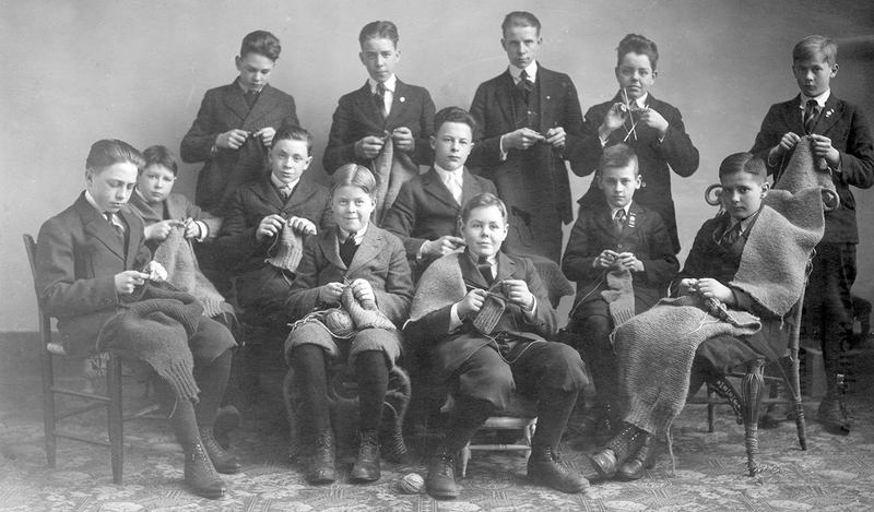 High school boys knitting for the soldiers during World War I, Cooperstown, New York, 1918.