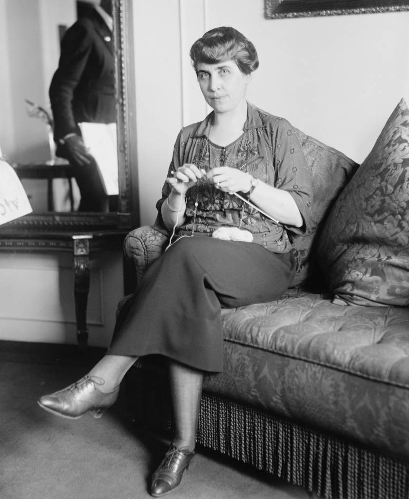 1921 portrait of Grave Coolidge (1979-1947), wife of then Vice President Calvin Coolidge knitting.