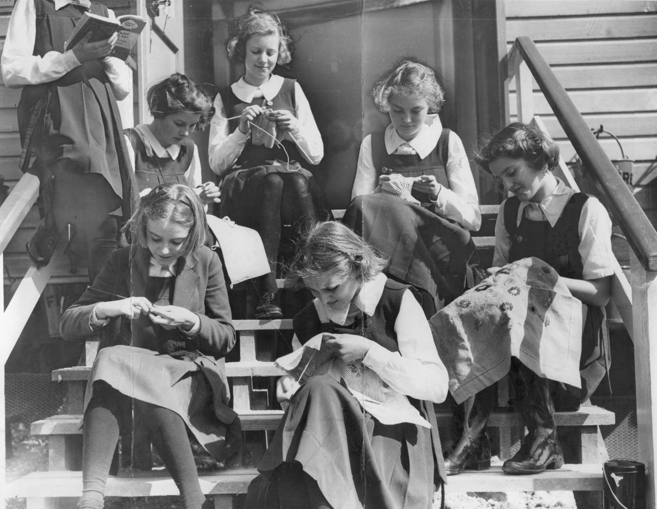 Schoolgirls Knitting On The School Steps At The First Of The Government's Elementary Camp Schools Built In Finnamore Wood Near Marlow Buckinghamshire. The Girls Are Some Of The 175 Evacuated From The Beal Modern School Ilford. Now They Live In The Self-contained Village Of Cedar Huts.
