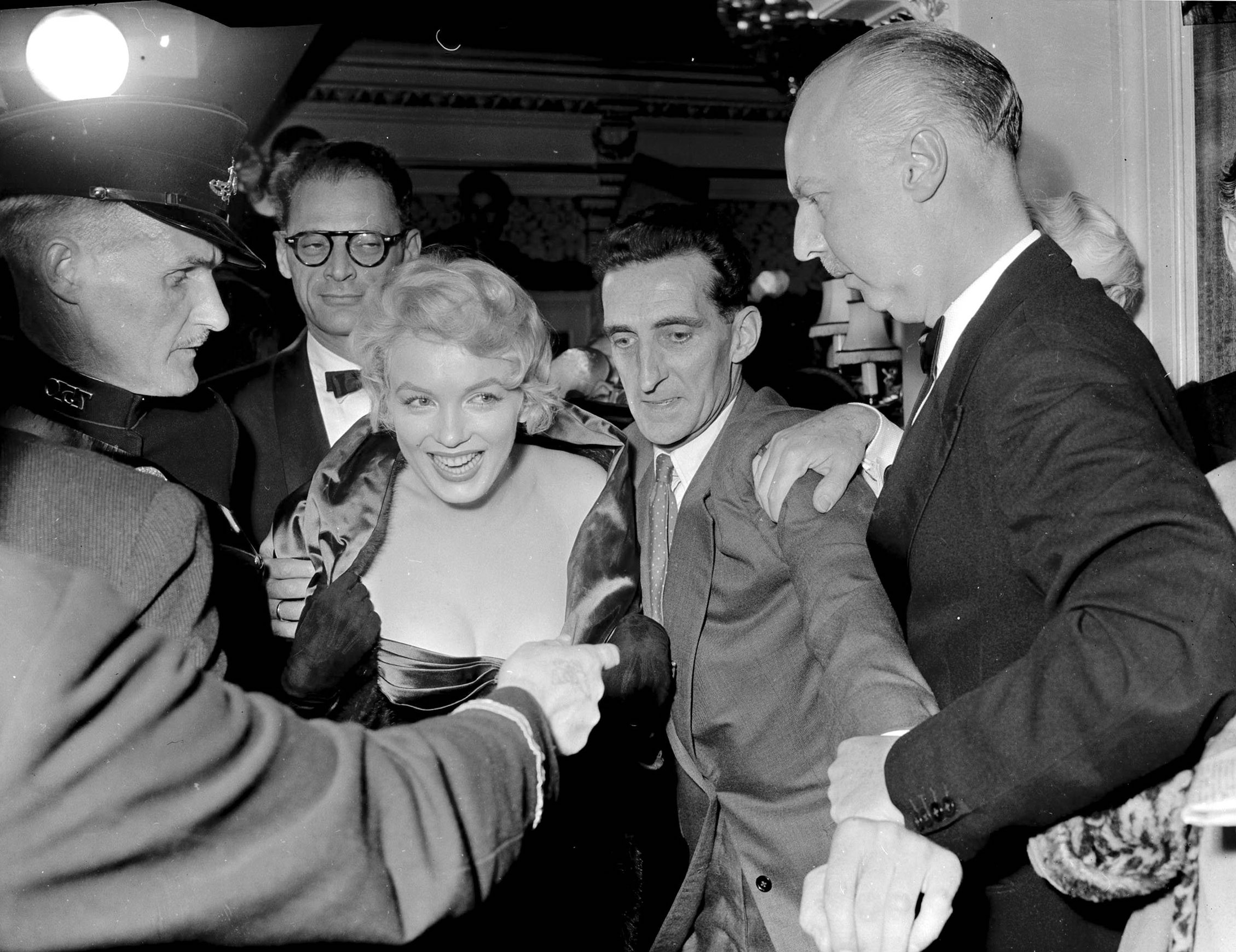 Marilyn Monroe and Arthur Miller in the crush outside the Comedy Theatre for the first night of A View From A Bridge.