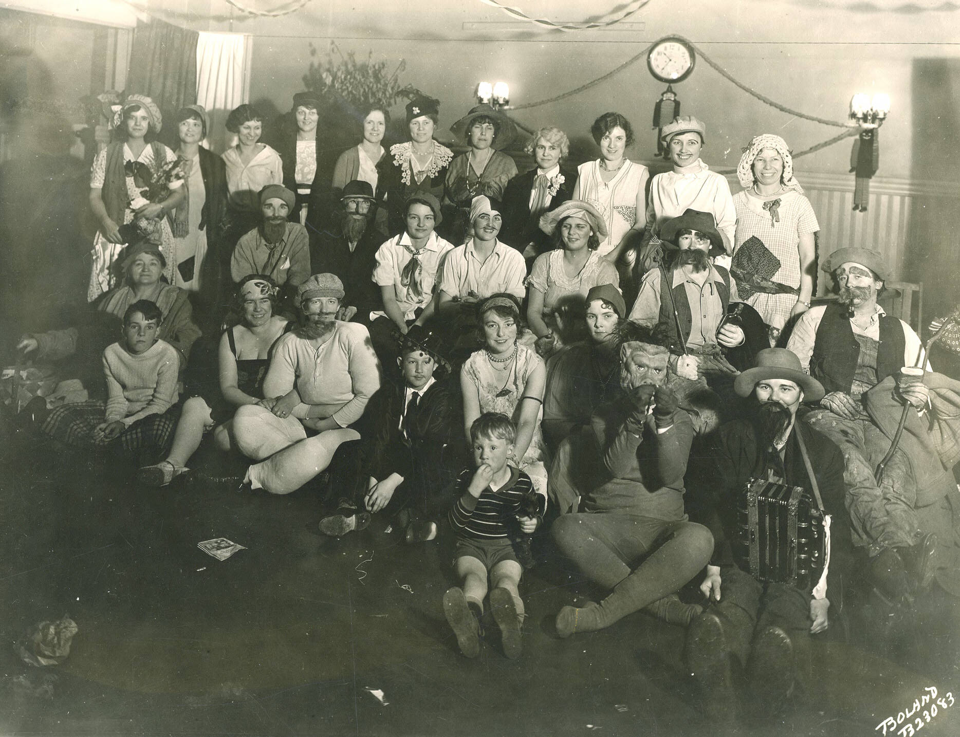 These telephone operators and their families enjoyed a Halloween party in October of 1930. Costumes of gold miners, hobos, strongmen, wandering musicians and one gorilla were on display. In 1930 the Pacific Telephone & Telegraph Company provided local and long distance service to the residences and businesses of Tacoma. At that time their main office was at 919 Market. Names of those in attendance were not provided.