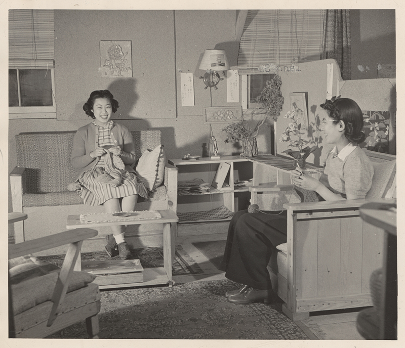 Mrs. S. Nako and Mrs. William Hosokawa spend an afternoon knitting at the Heart Mountain Relocation Center in Park County, Wyoming, January 8, 1943.