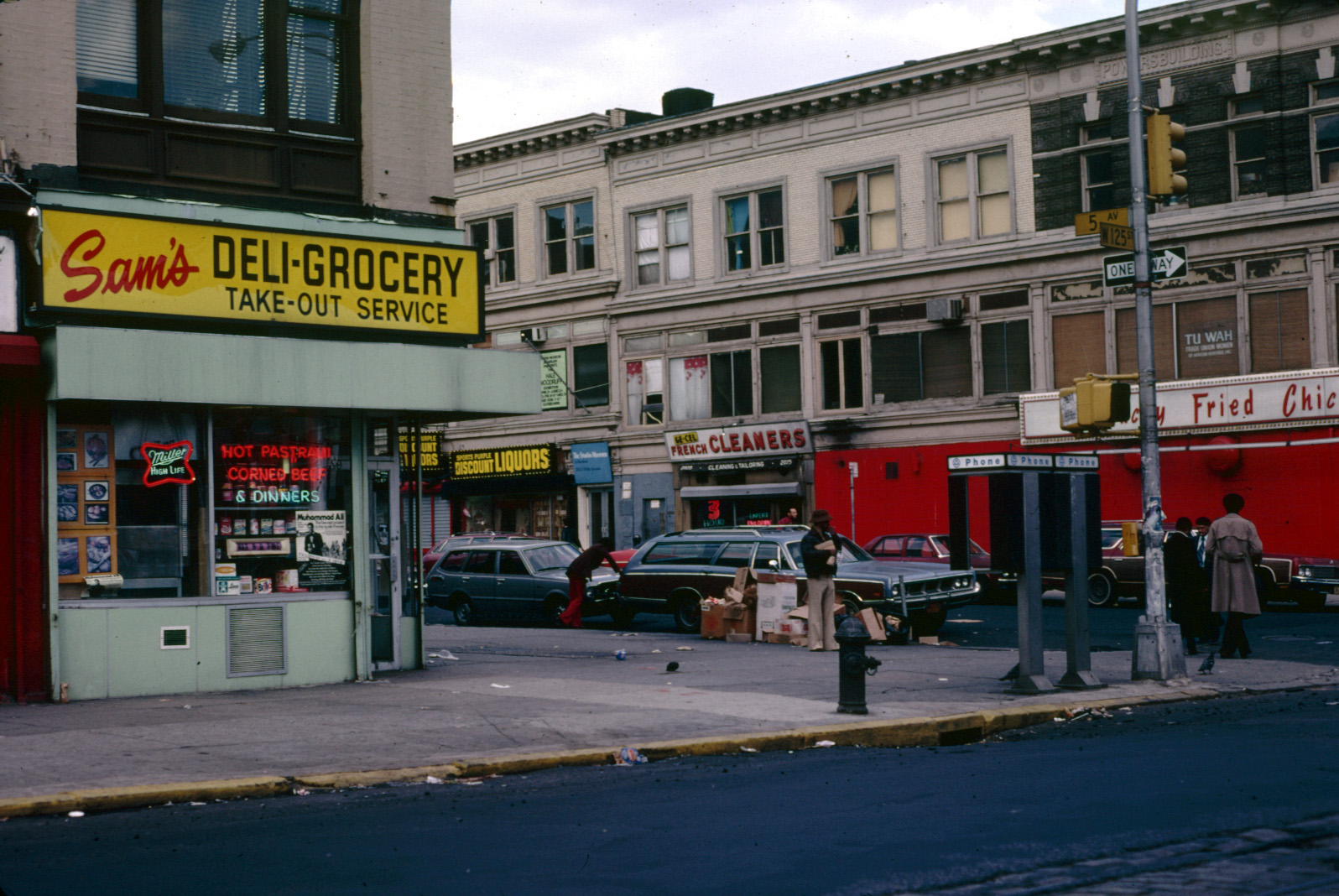 1979 New York City 5Av W125 St New York City Harlem April 1979. This was my last day in NYC. As I started to make my way to the airport, I drove through Harlem. I Took a picture each time I came to a red light.