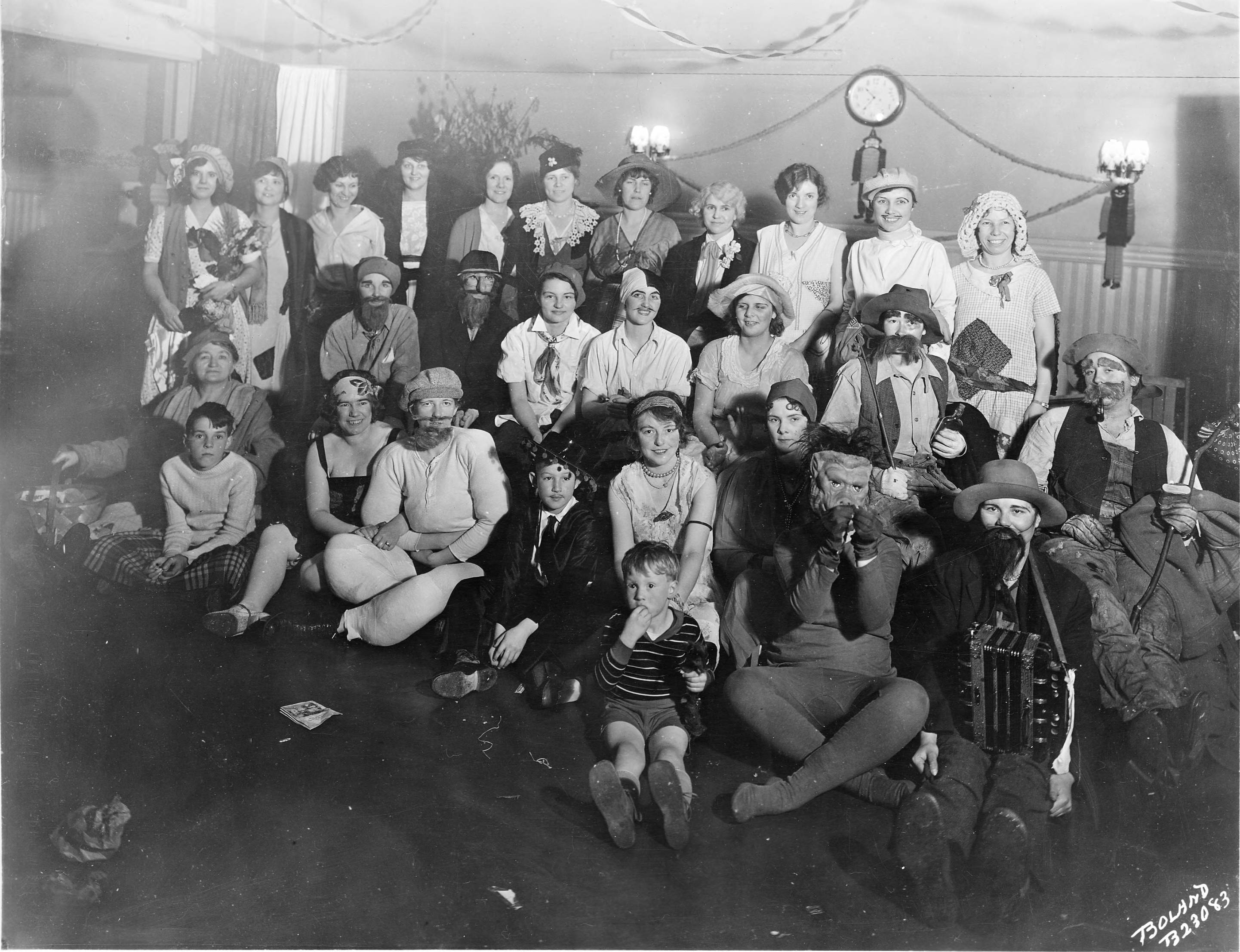These telephone operators and their families enjoyed a Halloween party in October of 1930. Costumes of gold miners, hobos, strongmen, and wandering musicians were on display. Names of those in attendance were not provided.