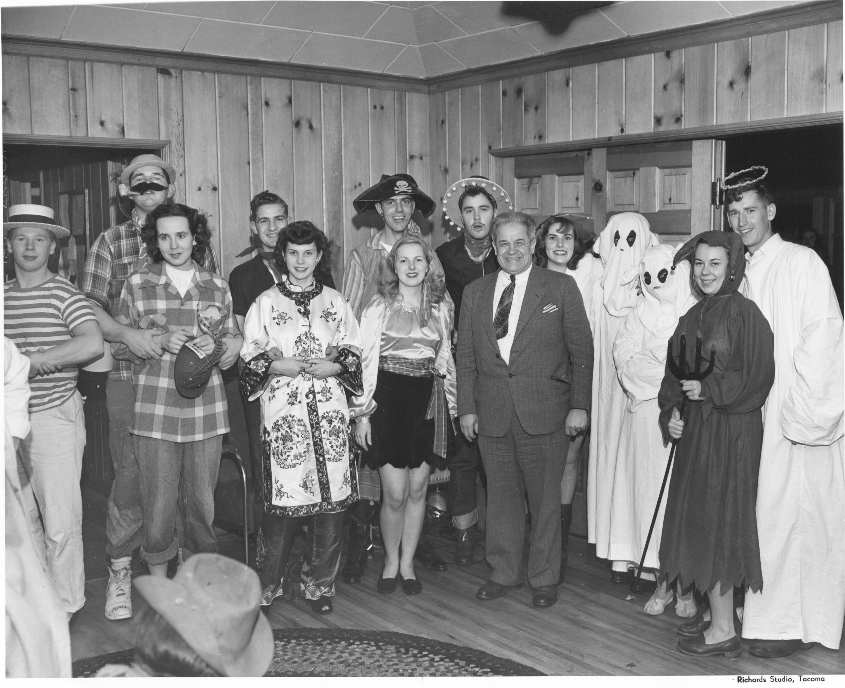 In October of 1947, the Sigma Nu fraternity at CPS (UPS) hosted a Halloween costume party for fraternity members and their guests. The various revelers dressed up as angels, devils, ghosts and pirates. The distinguished fellow who seems to be dressed as a college professor was in fact Dr. Charles T. Battin, Professor of Economics and Chairman of the Social Studies Division. The couple behind him are Edwin G. Cook III (in sombrero) and, to the right next to ghost, Barbera Jean (Rojean) Knight. The pair married on December 31, 1947.