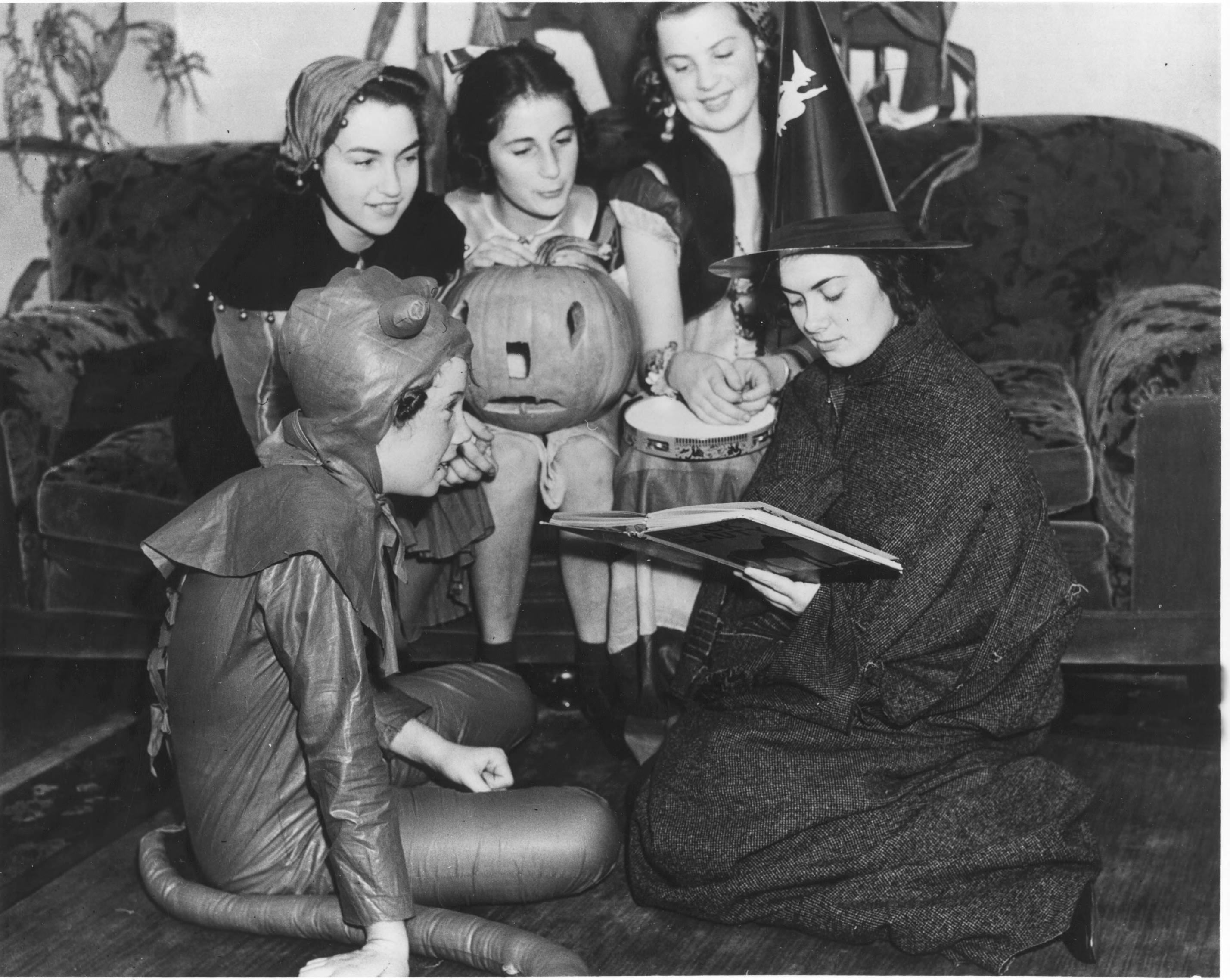 Hostess Peggy Grumbling, left, and three of her friends listen to a scary story read by a Halloween witch at this costume party held at the home of her parents, Mr. and Mrs. Alfeus Grumbling. The girls also enjoyed games directed by Miss Helen Poe. ( T. Times 10/31/1938, pg. 11)