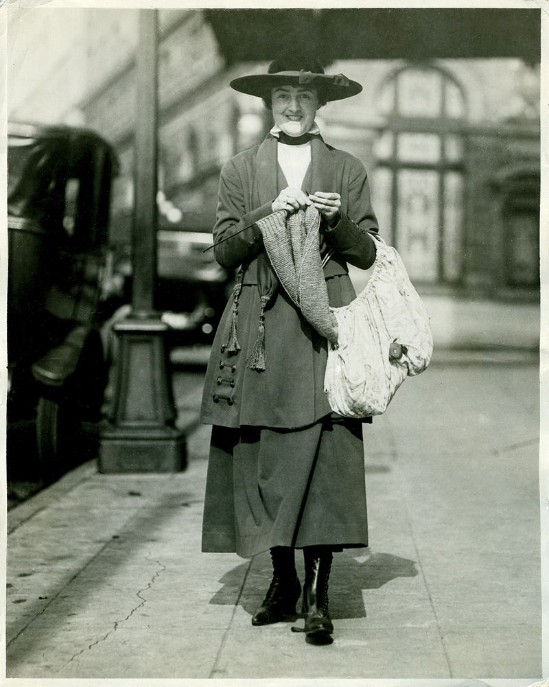 Seattle woman knitting while walking, c. 1918.