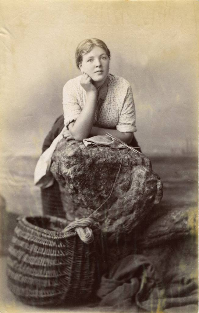 Studio portrait of young Scottish woman with her knitting, c. 1915.