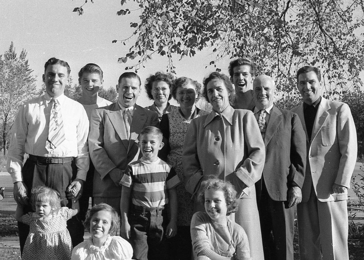 Leonard Family outside Stanley Leonard, unknown boy, Clair Leonard, unknown woman, Blanche, Zoe, Bob, Leopold and Max in front yard of house at 276 S. Carbon Ave. in Price, Utah.