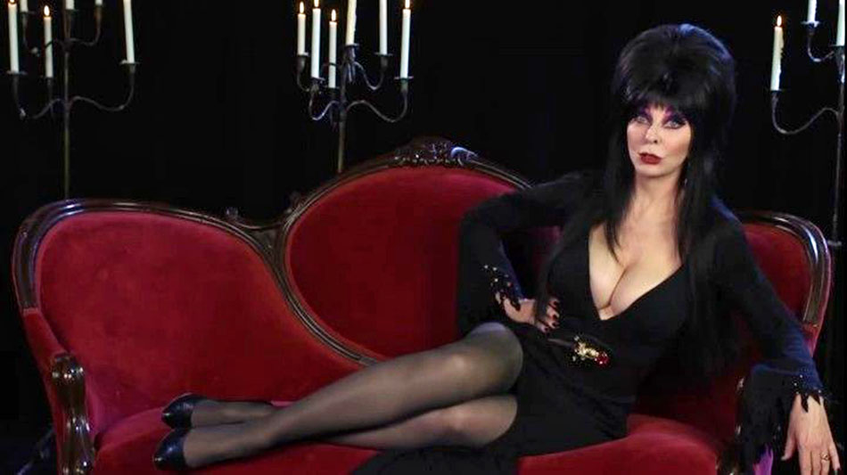 Elvira, on her usual couch, on Movie Macabre