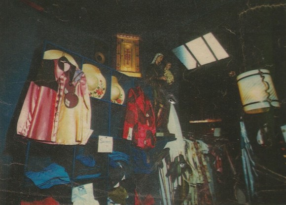Note Alkasura's trademark cherry motif on the satin shirt and jacket and religious artefacts as display items. Photographer: Unknown. Paul Gorman Archive. No reproduction without permission