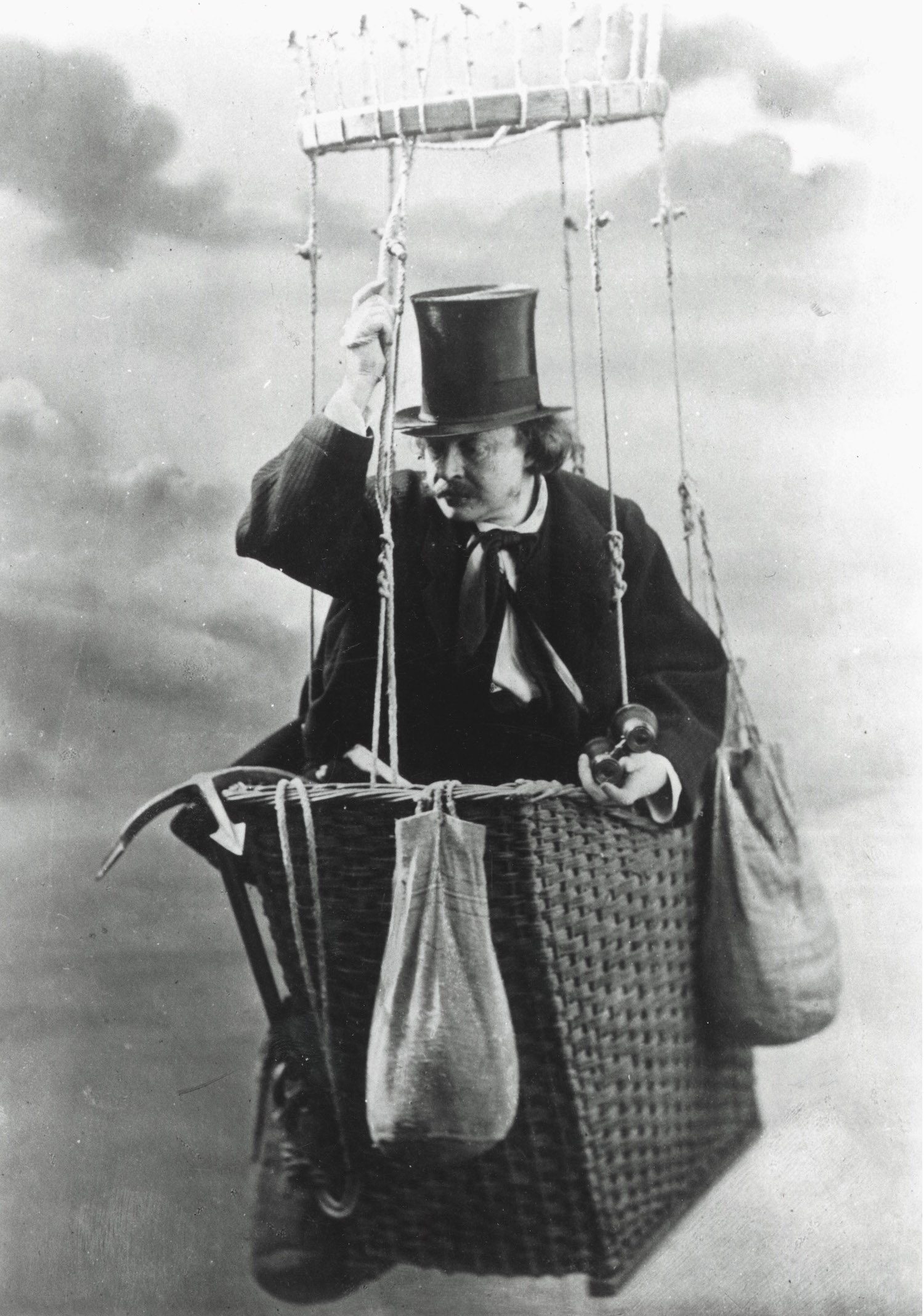 Felix NADAR, 1820-1910, famous photographer, in the gondola of his balloon, photograph. Nadar built his Géant in 1858 and launched it in 1863, the year Jules Verne published Five weeks in a balloon