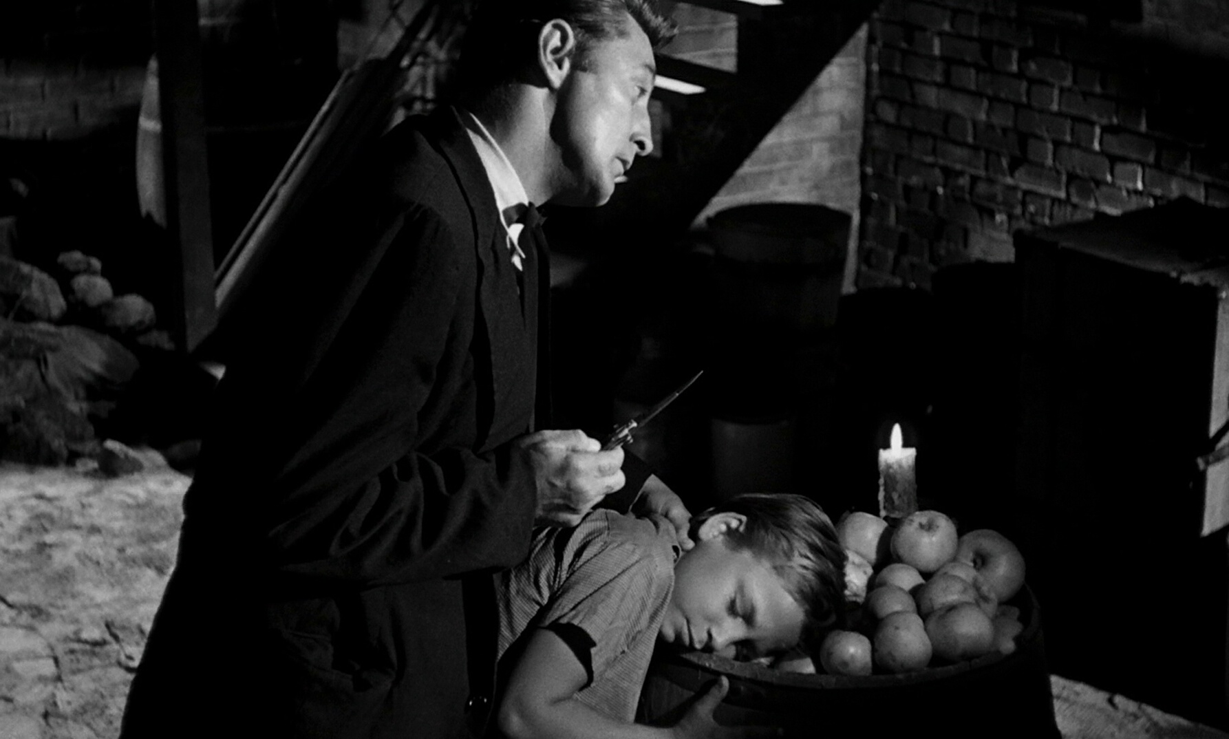 Robert Mitchum and Billy Chapin in The Night of the hunte