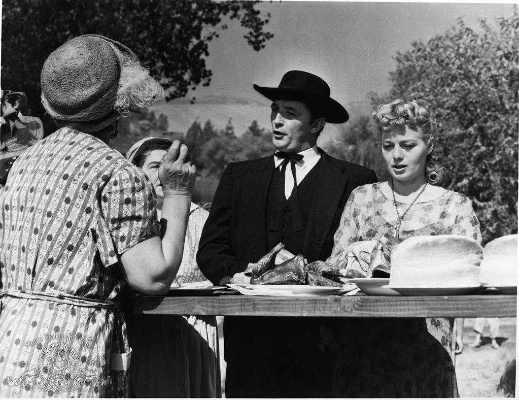 Robert Mitchum and Shelley Winters in The Night of the hunter directed by Charles Laughton, 1955