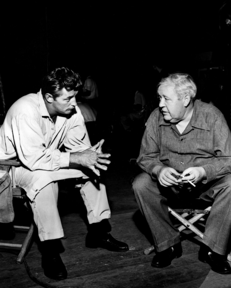 Robert Mitchum with director Charles Laughton