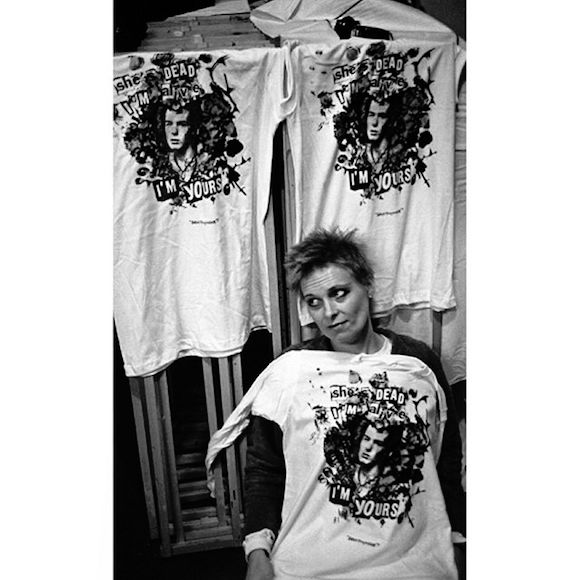 Westwood with freshly printed t-shirts bearing the design She's Dead I'm Alive I'm Yours, produced upon the death in New York of Sid Vicious' girlfriend Nancy Spungen, October 1978