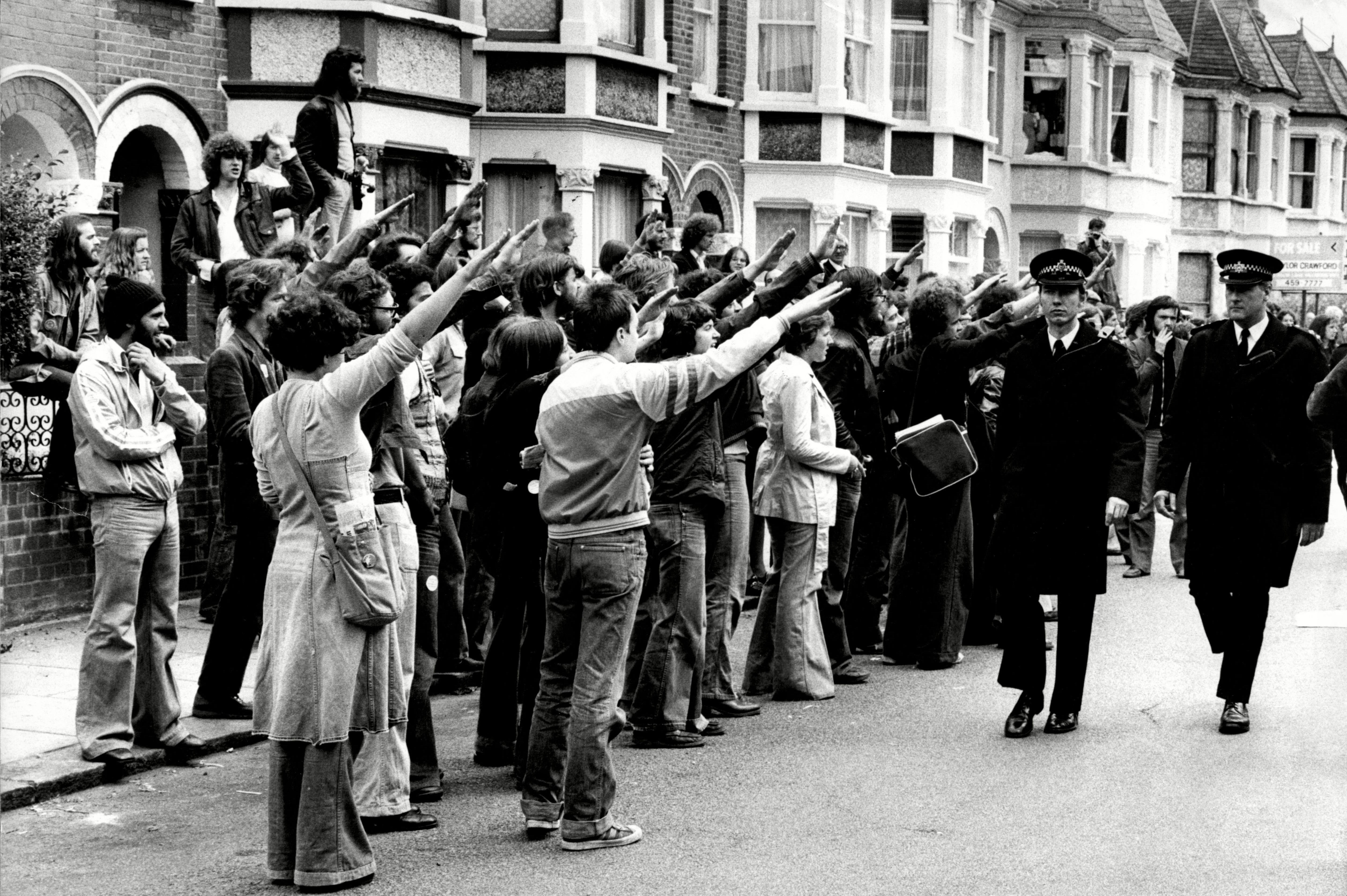 Strikers Give The Nazi Salute To Police Outside The Grunwick Film Processing Plant In North London.