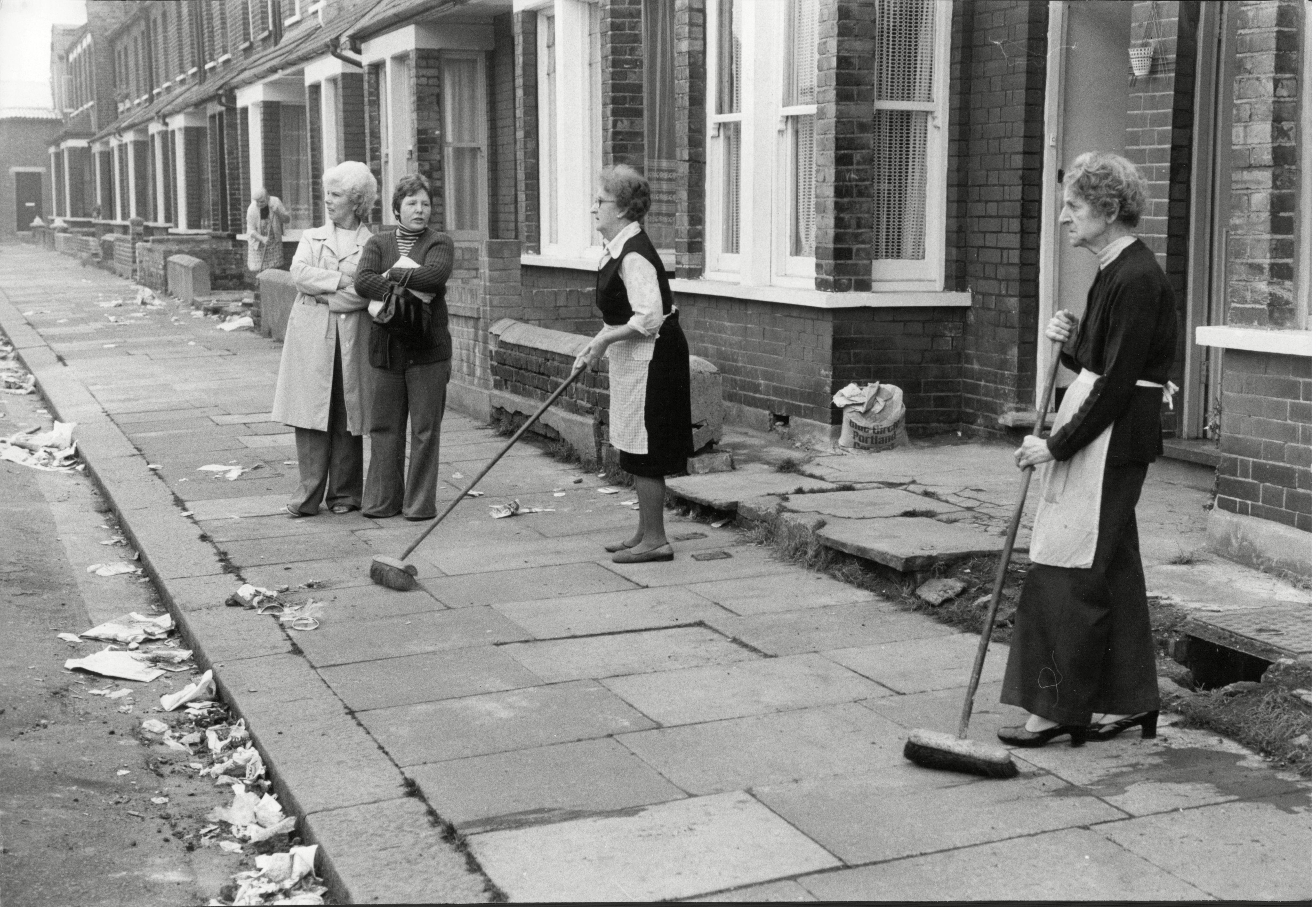 Residents Of Cooper Road N.w.16 Sweep The Debris Away From Their Front Door After The Grunwick Mass Picket