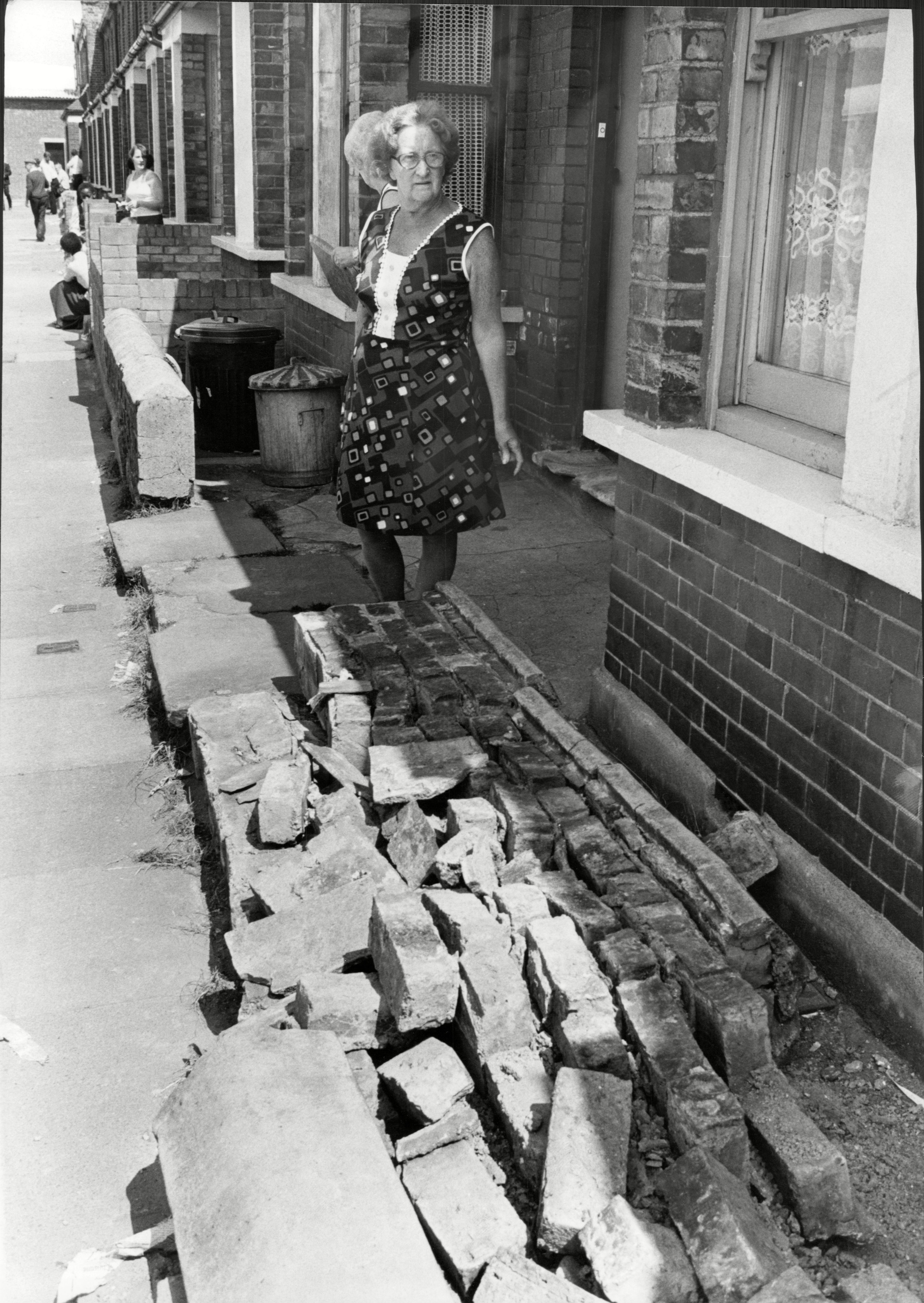 Mrs Lena Wood Surveys The Remains Of Her Front Wall After Clashes Between Police And Pickets At The Grunwick Factory