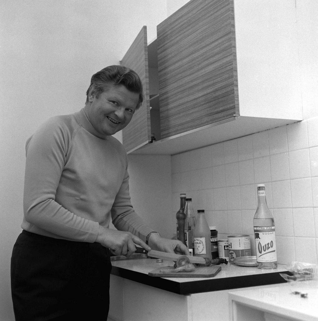 Benny Hill in his flat in the kitchen on Queensgate, London, January 1969