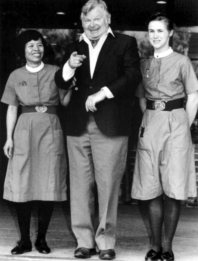 Benny Hill leaving hospital after heart trouble.