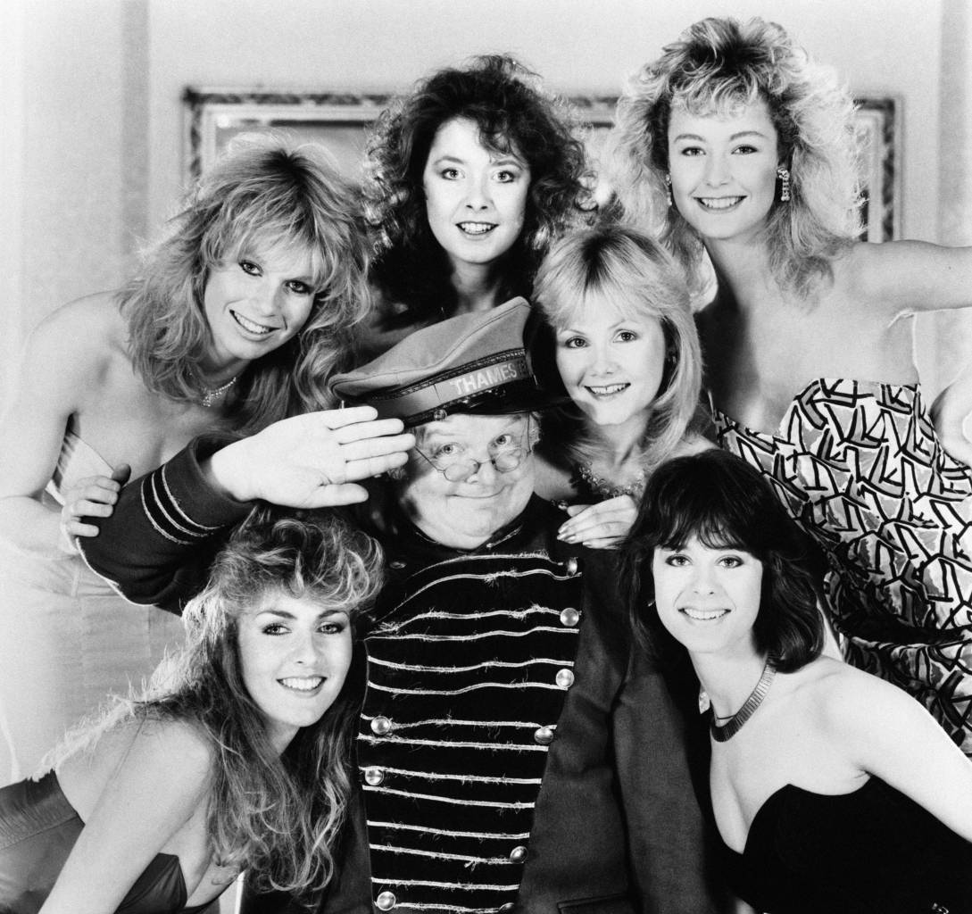 Comedian Benny Hill in 1986 with his Hill's Angels: (top, l-r) Selina Caston, Lorraine Doyle, Sue Upton, Natalie Rolls; (bottom, l-r) Zoe Bryant, Liz Jobling.