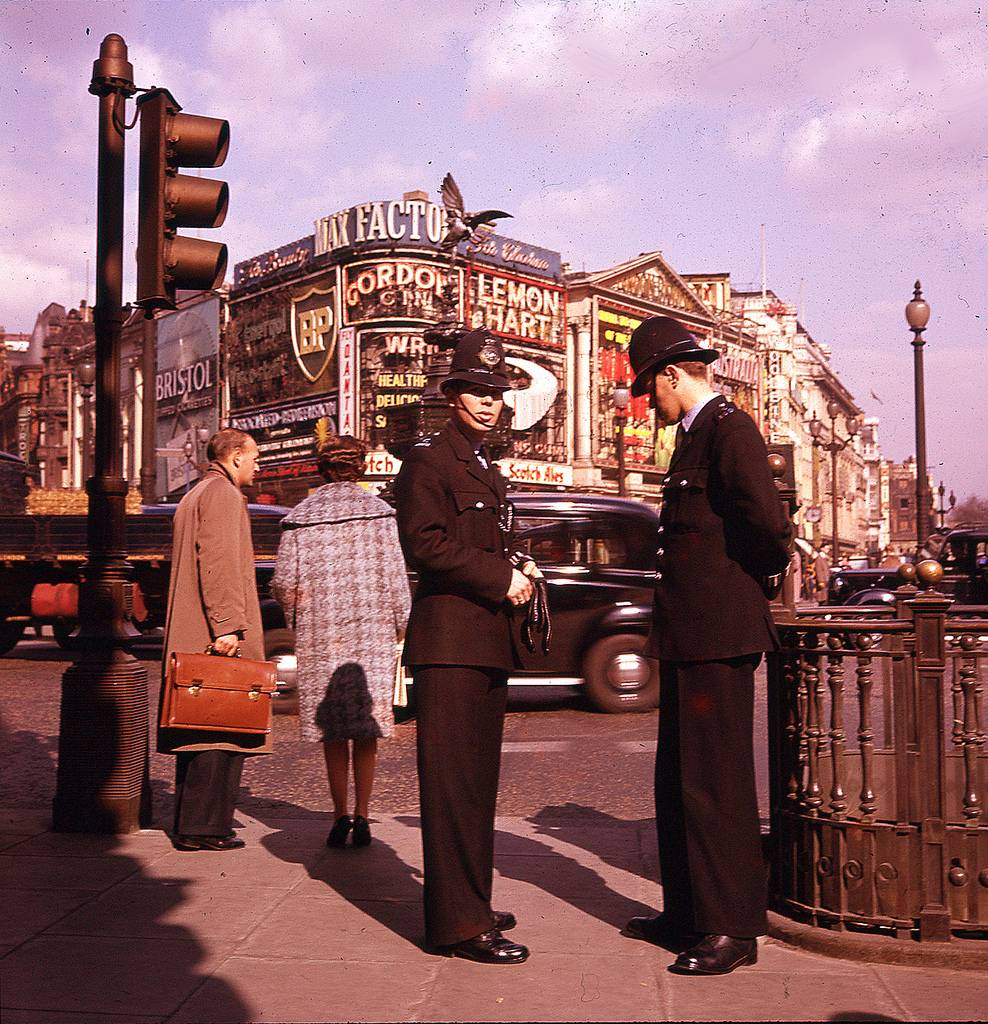 Bobbies in London Piccadilly Circus 1966 by Michael Rogge