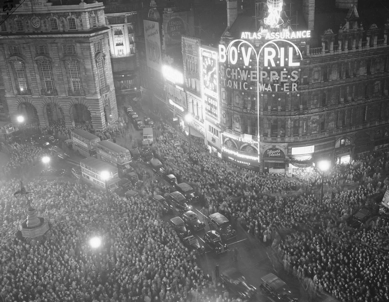 After nearly 10 years of comparative gloom, the bright lights of Piccadilly Circus come back to London, April 2, 1949, when the ban on the use of electricity for outdoor advertising was lifted at noon. This is the scene as crowds watched the signs light up again. The ban will be re-imposed on October 2.