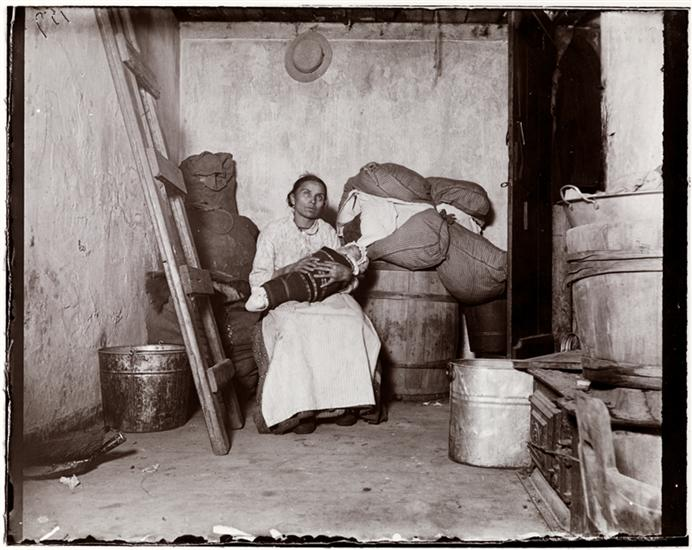 In the home of an Italian Ragpicker, Jersey Street. DATE:ca. 1890 Italian mother and her baby in Jersey Street.