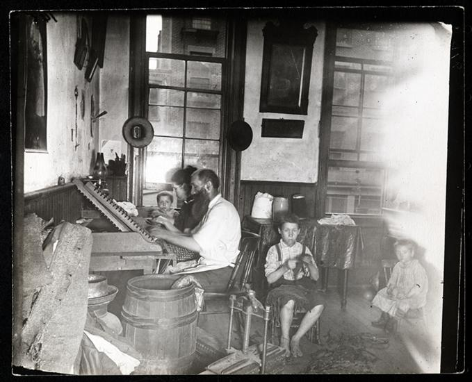 Bohemian cigar makers at work in their tenement. DATE:ca. 1890