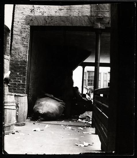 Arch under the first rear tenement at 55 Baxter Street leading to the second rear, with stairs up which Vincenzo Nino went to murder his wife in 1895. House believed to be haunted. DATE:ca. 1890