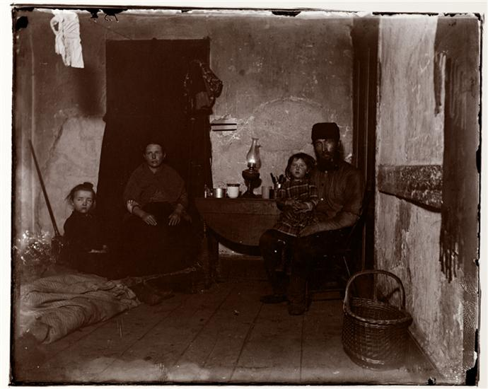 In Poverty Gap, West Twenty-Eighth St. An English Coal-Heaver's Home. DATE:ca. 1890