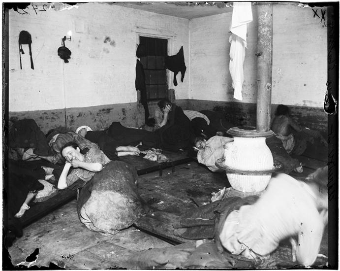 Women's Lodging Room in Eldridge Street Police Station. DATE:ca. 1890 Women sleeping on plank beds and the floor.