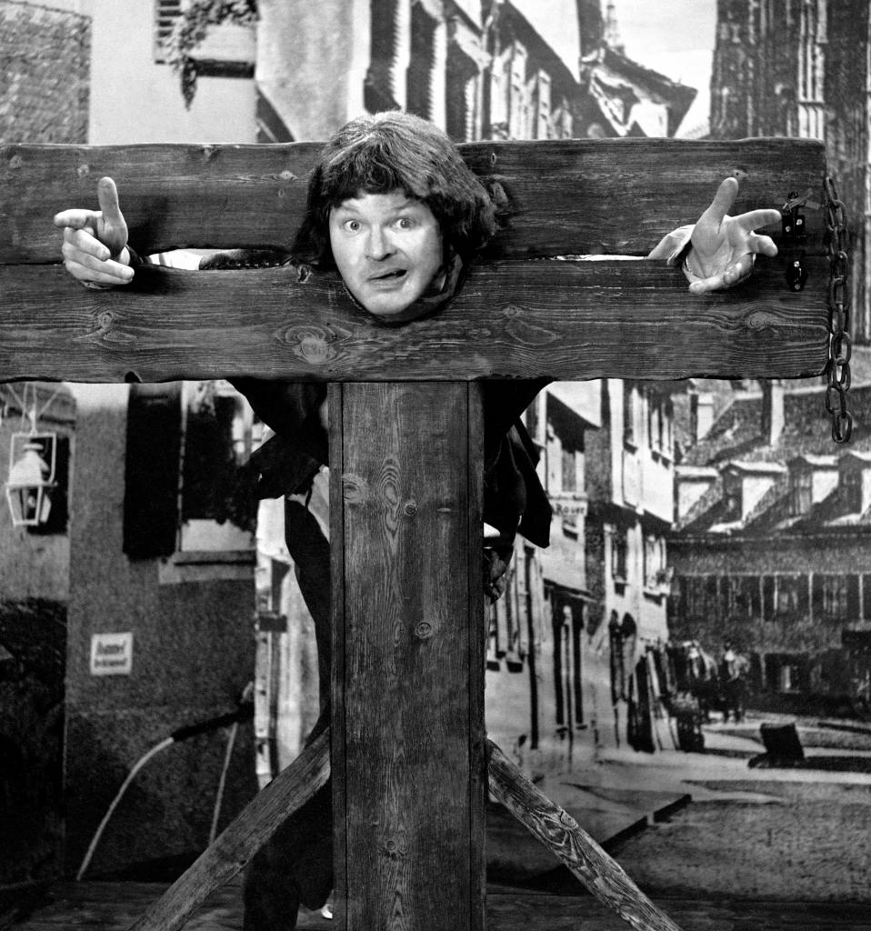 Benny Hill in the stocks for a 1961 series of the Benny Hill Show.