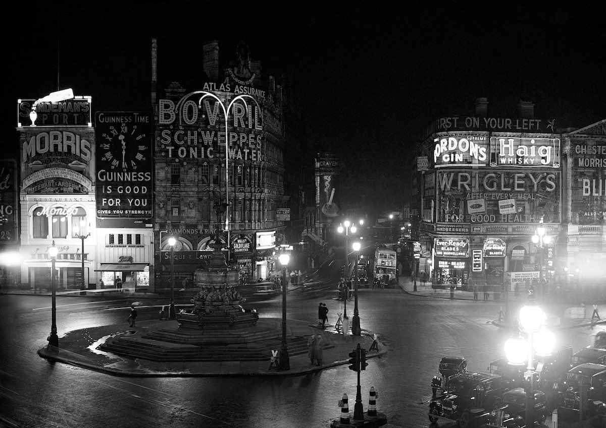 After being postponed for 24 hours owing to bad weather conditions, London's big black out took place last night, and it was observed not only in London but over the whole of south-east England and the midlands lights wert all extinguished, cars only being allowed to proceed with their dim side lights burning complete darkness reigned everywhere with only one or two receptions where the timing. Apparatus of street lamps had some wrong and with searched lights stabbing into the night sky as their exercises proceeded overhead, the scene was vividly reminiscent of an air raid during the last war. A view of a night, before the great black-out began in London August 10, 1939. (AP Photo)