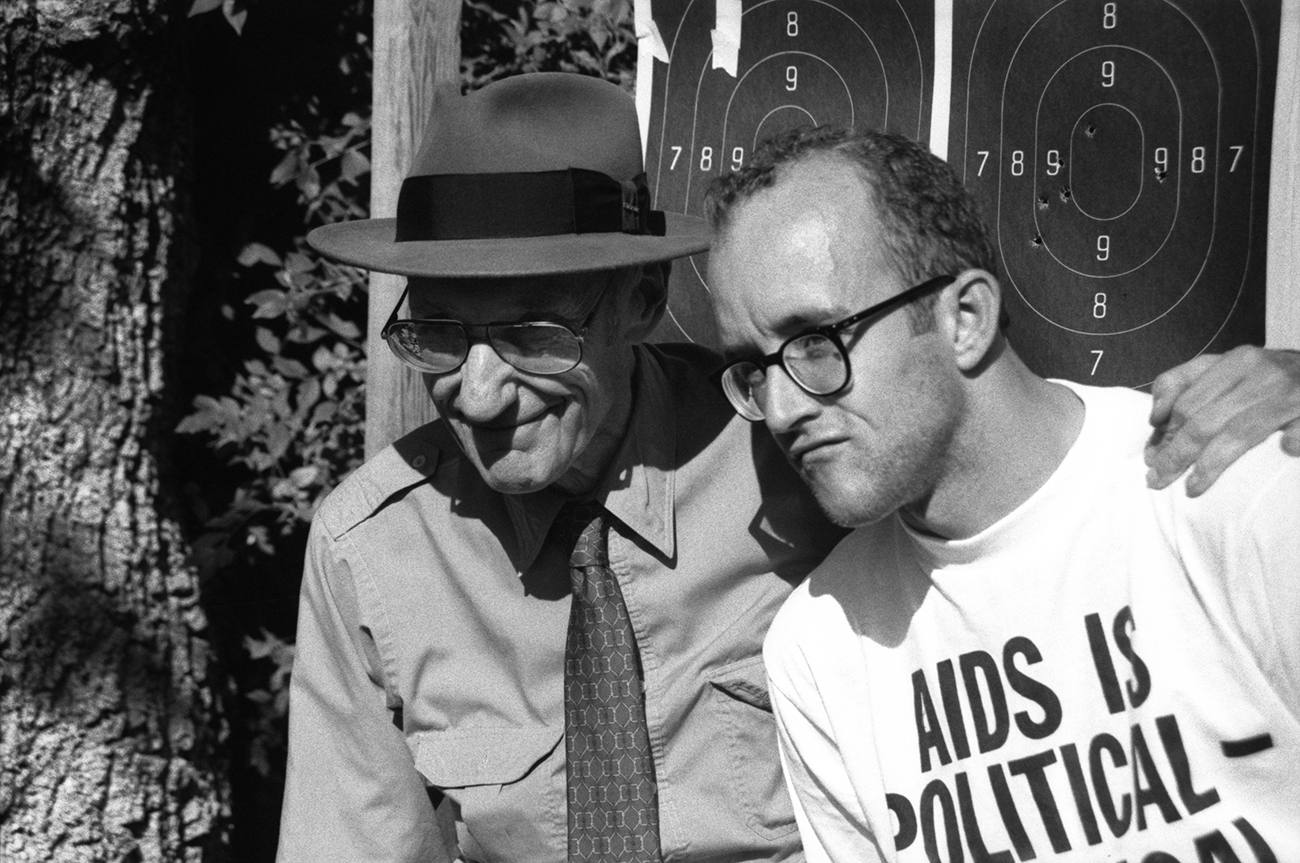 William Burroughs and Keith Haring pose in front of targets. Kansas