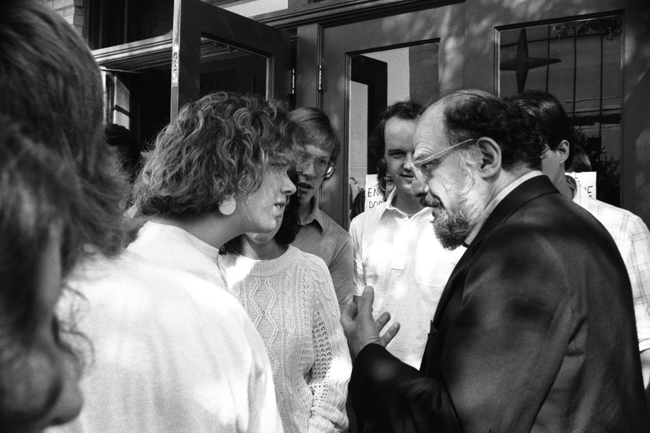 Allen Ginsberg speaks with onlookers outside Liberty Hall. Kansas 1987